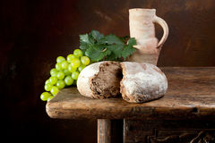 Wine jug with rustic bread Stock Photos