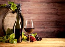 Wine with keg. Still life of wine with wooden keg Stock Images