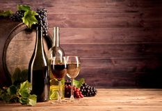 Wine with keg. Still life of wine with wooden keg Stock Photo