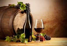 Wine with keg. Still life of wine with wooden keg Stock Photos