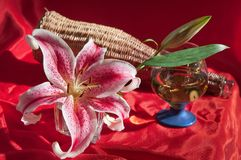 Wine and lily. Royalty Free Stock Image