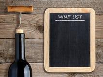 Wine list on blackboard and wine bottle stock image