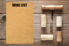 Wine list and corks with corkscrew Royalty Free Stock Image