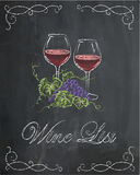 Wine list with two wine glasses and grape on chalkboard backgrou Stock Photos