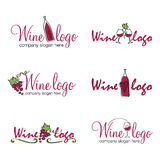 Wine logos (vector). Set of six wine logos with wine bottles, glasses, vines and leaves. Vector format available Stock Photography