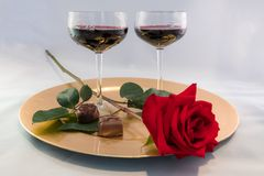 Wine and Long Stemmed Rose Royalty Free Stock Image