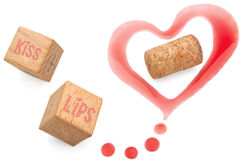 Wine love marks and cork. Heart of red wine marks and cork,playing cubes on white background Royalty Free Stock Images