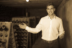 Wine maker in cellar with wine bottles storage Stock Photography