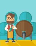 Wine maker inspecting wine from barrel Stock Image