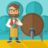 Wine maker inspecting wine from barrel. Royalty Free Stock Photos