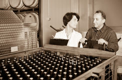 Wine maker showing bottles with wine. Wine maker showing to expert of bottles with the wine Royalty Free Stock Photos