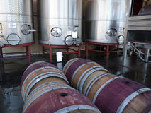 Wine making tanks and barrels. Wine making equipment and wooden barrels in a winery in Napa Valley California Stock Photo