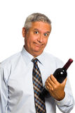 Wine man. Handsome middle age man drinking wine from a bottle on a white background royalty free stock photo