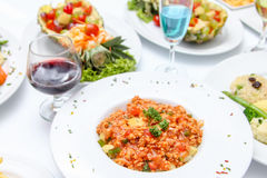 Wine and many food Stock Photography