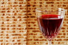 Wine and Matzah. Wine glass with matzah background for Passover Stock Photos