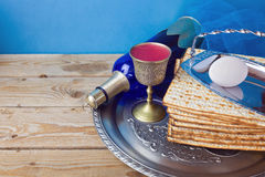 Wine and matzo for Jewish holiday Passover on wooden table Stock Image