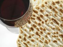 Wine and matzoh. Red wine and matzoh - tradition jewish passover bread close up royalty free stock photography