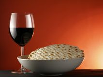 Wine and matzoh. Over red background stock photo