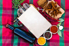 Wine with meat delicacies. Spicy pepper, paprika, bay leaves, ga Royalty Free Stock Photography