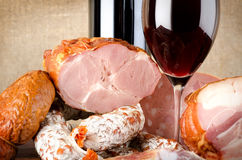 Wine and meat products Stock Images