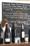 Wine and menu board at restaurant Royalty Free Stock Photo
