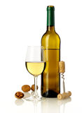 Wine, nuts and bottle opener Stock Photography