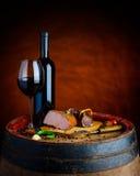 Wine och meat arkivbild