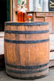 Wine in old bottle on a barrel. Royalty Free Stock Photo