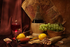 Wine and old maps Royalty Free Stock Images