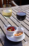 Wine with olives and nuts Royalty Free Stock Photos