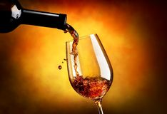 Wine on orange background Royalty Free Stock Photo