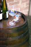 Wine over wood barrel Stock Photography