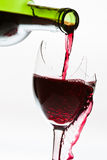 Wine overflow in the the broken glass Stock Image