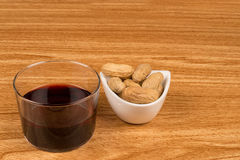 Wine and peanuts Stock Photography