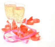 Wine and petals of roses Royalty Free Stock Photography