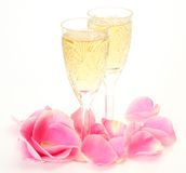 Wine and petals of roses Stock Images