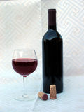 Wine Photo 3. A Wine bottle, wine glass and corks stock photography