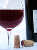 Wine Photo 4. A closeup of a wine glass, wine bottle and corks stock photos