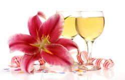 Wine and pink lilies Royalty Free Stock Photos