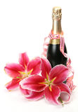 Wine and pink lilies Royalty Free Stock Photography