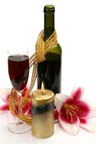 Wine and pink lily Stock Image