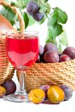 Wine and plums Royalty Free Stock Photography