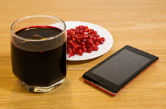 Wine, pomegranate seeds and mobile phone. Are on the table Royalty Free Stock Photo