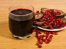 Wine and pomegranate seeds. Are on a table Stock Image