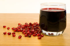 Wine and pomegranate seeds. Are on a table Royalty Free Stock Images