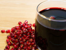 Wine and pomegranate seeds. Are on a table Stock Photos