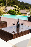 Wine on the pool Royalty Free Stock Photography