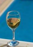 Wine poolside Royalty Free Stock Photo