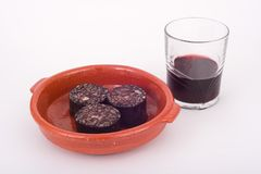 Wine and pork blood pudding. Wine and fried pork blood pudding with rice stock images