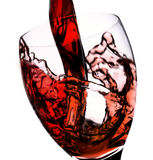 Wine pour. Red wine pour on white background Royalty Free Stock Photography